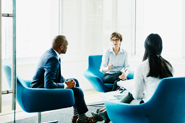 Group of people in an office setting having a discussion